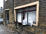 A 22-year-old man smashed through the front window of this house in Bradford on Friday night