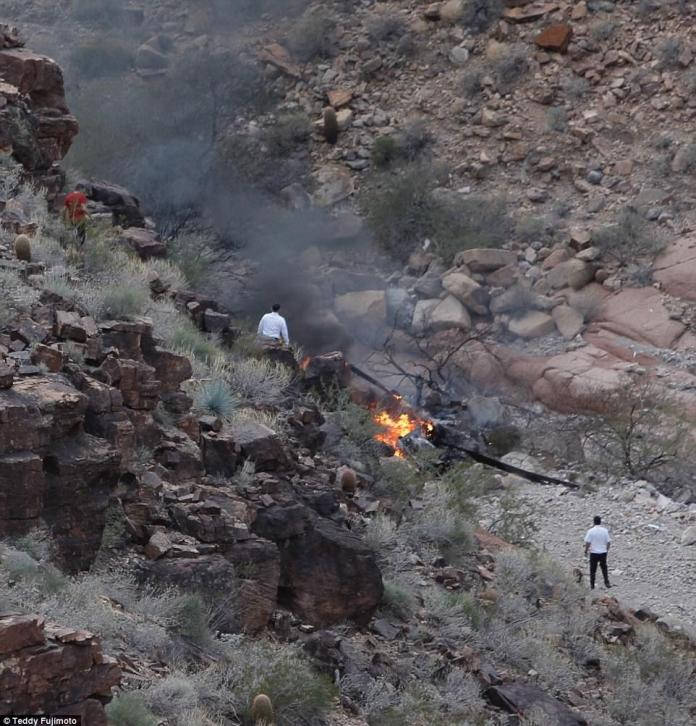 Four survivors of a tour helicopter crash in the Grand Canyon were airlifted to a Nevada hospital on Sunday nine hours later while crews were recovering the bodies of three others