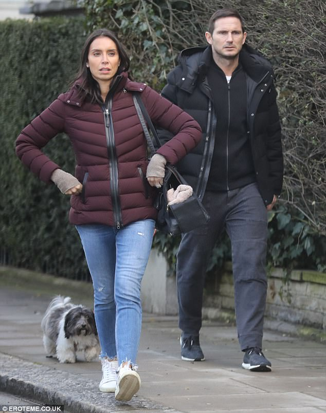 All wrapped up:The former The One Show host kept casual in a padded maroon coat, which she teamed with skinny jeans and white trainers