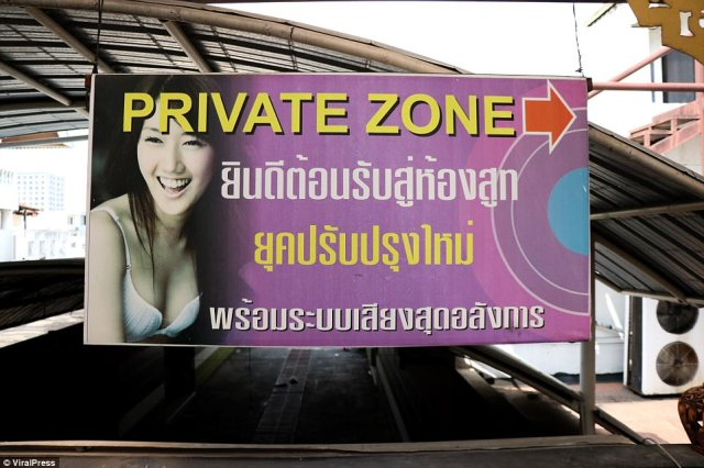 Multi-storey massage parlours like this one have been accused of illegally hiring minors and migrant workers, amid allegations of huge bribes being passed to local police