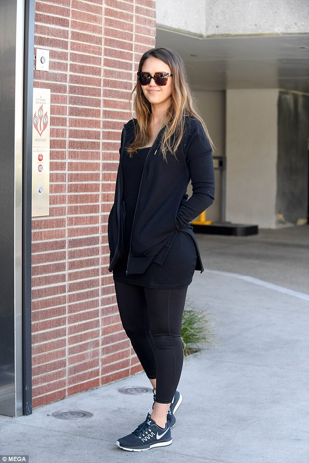 Sports chic: The actress was seen looking picture perfect in her casual, sports chic ensemble which consisted of a plunging skintight black vest and ankle-grazing leggings