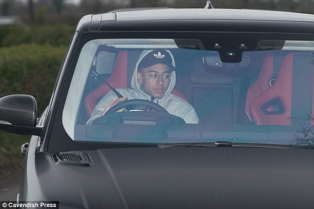 Jesse Lingard is pictured driving his Range Rover into training on Wednesday morning