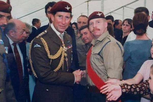Wayne Domeney (pictured with Prince Charles) is believed to be in County Durham and is wanted by police so he can be sentenced
