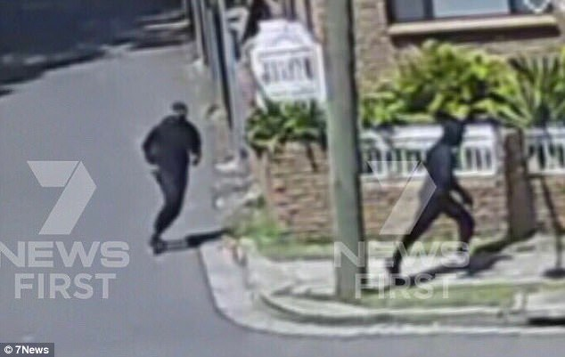 A balaclava-wearing assailant fired multiple bullets at the father-of-two at about 12.10pm Pictured: Alleged suspects fleeing the scene