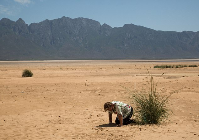 This is when most taps will be turned off and residents will have to queue at 200 standpipes installed in streets for diminishing water supplies. If insufficient rain falls when their winter arrives Cape Town has just over 100 days left before that fateful day arrives (local resident prays for rain amid the dust)