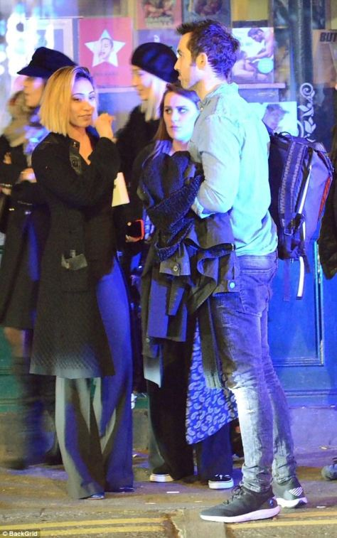 Night out:Her male companion took a more casual approach to the evening in a denim blue shirt and dark skinny jeans