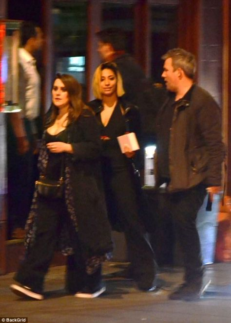 Out on the town: Karen wandered the streets flanked by her pals