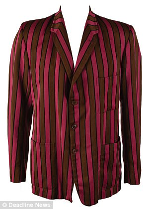 The prestigious private school attended by Tony Blair is investigating how one of its magenta and brown blazers (pictured) came to be in the wardrobe of Elvis Presley