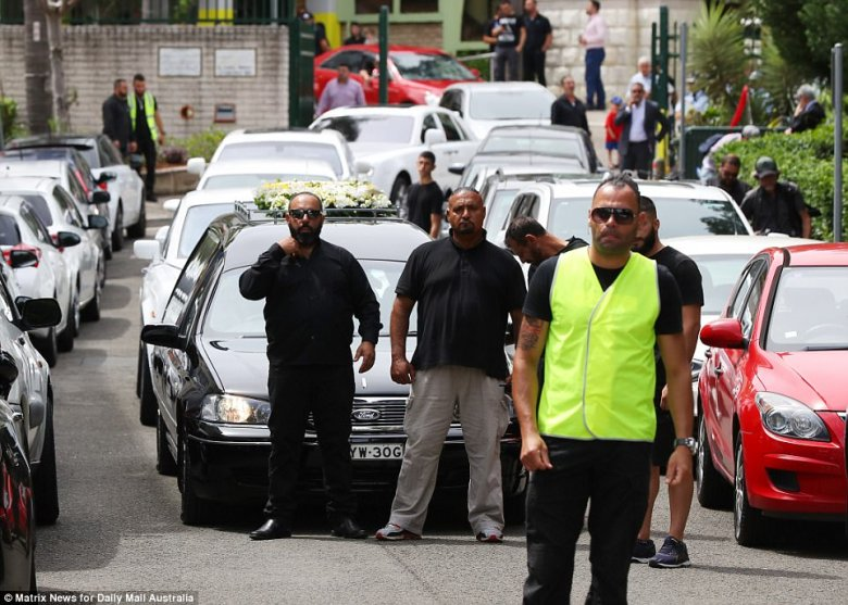 Hawi's coffin was taken from the mosque in a black hearse, accompanied by a lengthy funeral procession of white cars, following the service