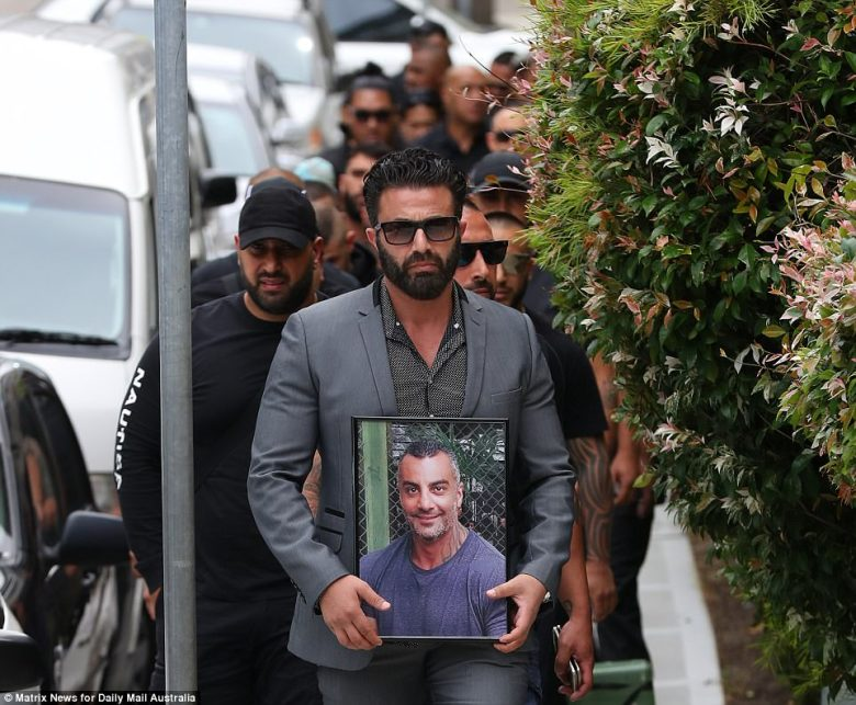 Meanwhile in Sydney: A man named Tony carried a framed photograph of his slain friend as he led a procession of mourners towards the Al Zahra mosque for Hawi's funeral