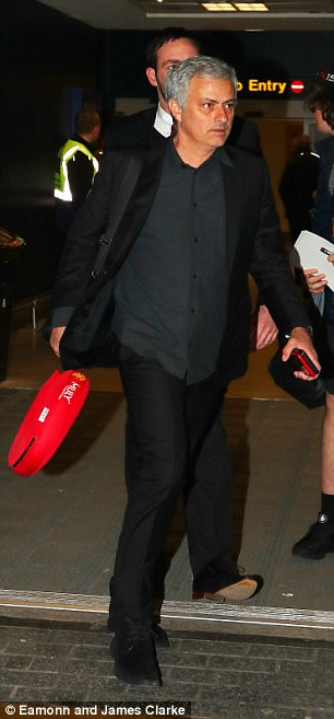 Jose Mourinho arrives back with the team