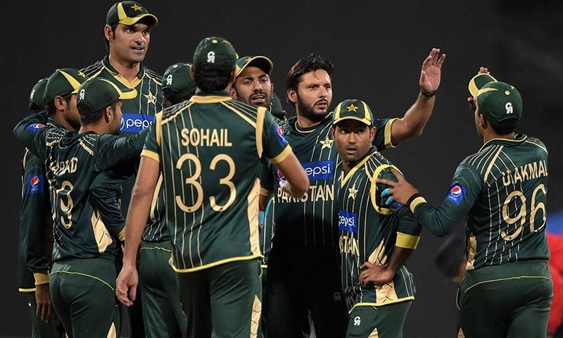 Pakistani captain and spinner Shahid Afridi celebrates with teammates after taking the wicket of New Zealand batsman Ross Taylor during the third Day-Night International cricket match between Pakistan and New Zealand at the Sharjah cricket stadium in Sharjah. -AFP Photo