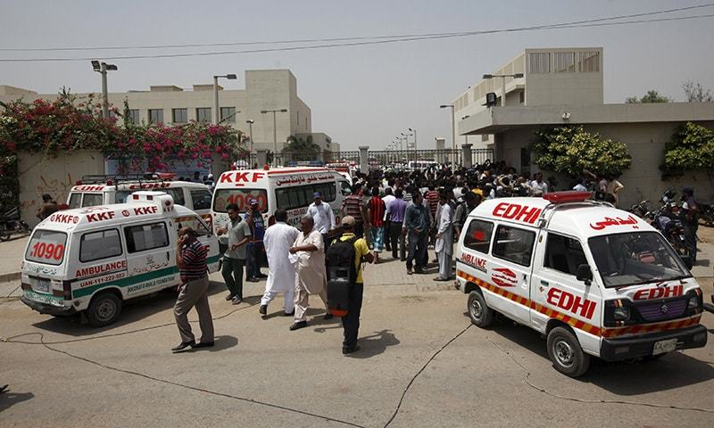 Ambulances and people gather gather outside a hospital after an attack on a bus in Karachi, Pakistan, May 13, 2015. — Reuters
