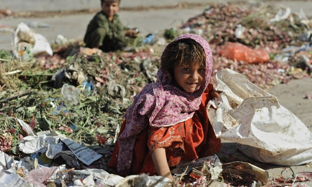 Children scavenge through the garbage in this file photo.