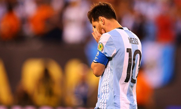 Lionel Messi of Argentina reacts after missing a penalty kick against Chile during the Copa America final at MetLife Stadium on June 26, 2016. — AFP