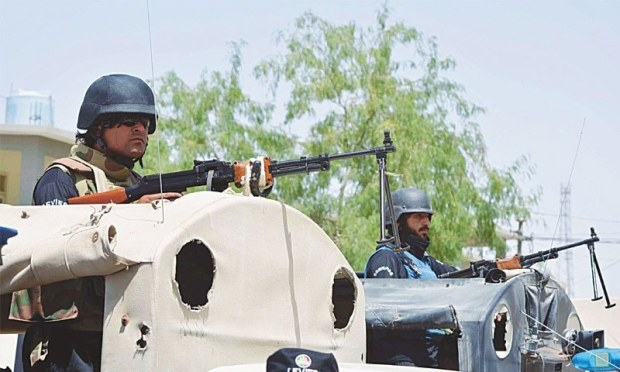 Security guards from the Quick Response Force on Friday stand alert in their vehicle at Chaman after the closure of the border gate.— INP