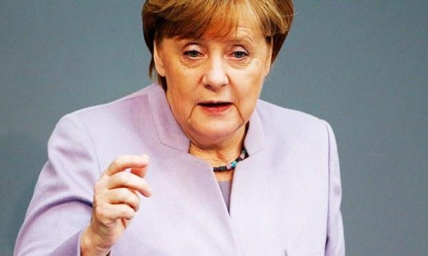 German Chancellor Angela Merkel addresses the lower house of parliament Bundestag in Berlin.—Reuters