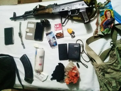 Firearms and other items discovered from Taukali's possession. —ISPR