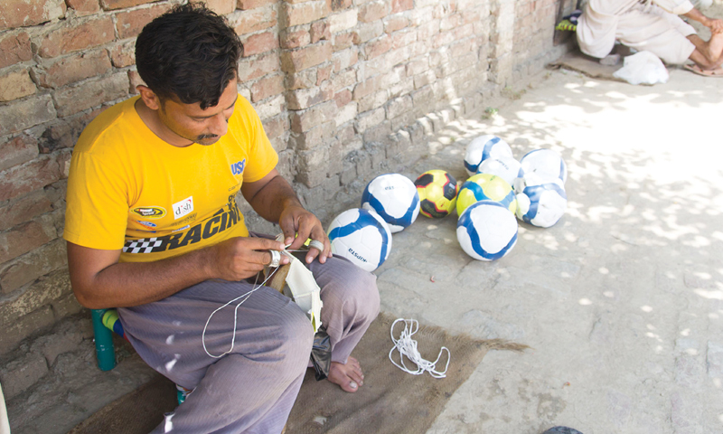 Hand-stitched footballs are produced in thousands on a daily basis at several hundred stitching centres across the district