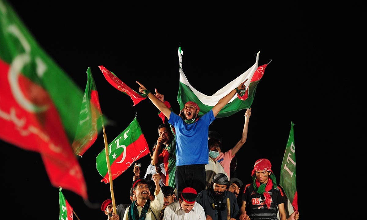 Supporters Imran Khan, wave party flags during an anti-government protest near the prime minister's residence in Islamabad on September 2, 2014. — Photo by AFP