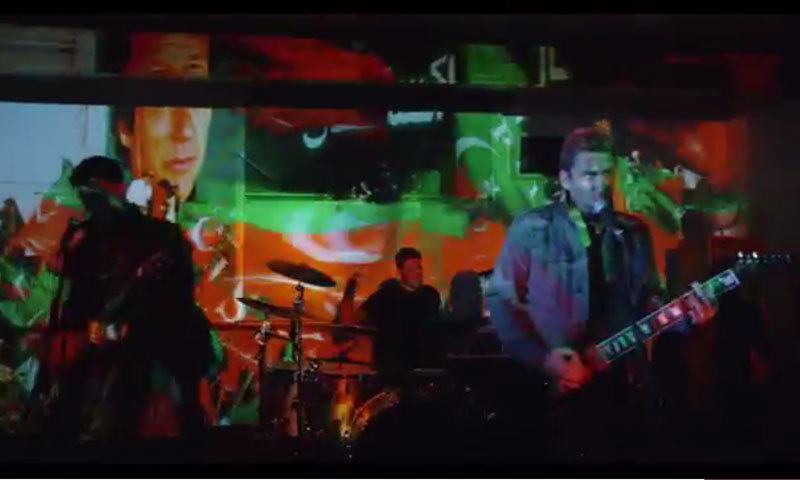 — Screengrab shows band playing in front of screen showing images from PTI rally