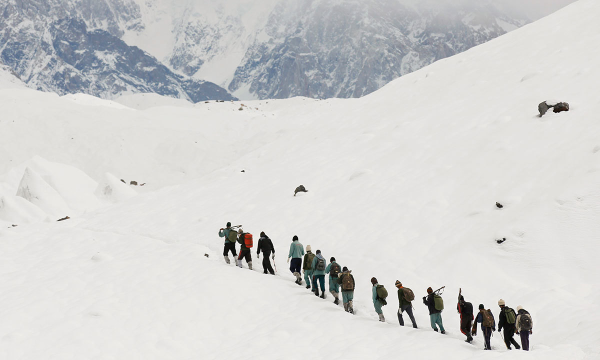 A group of Pakistani soldiers carry their guns uphill along the K2 base camp trek in the Karakoram mountain range in Pakistan. -Reuters Photo