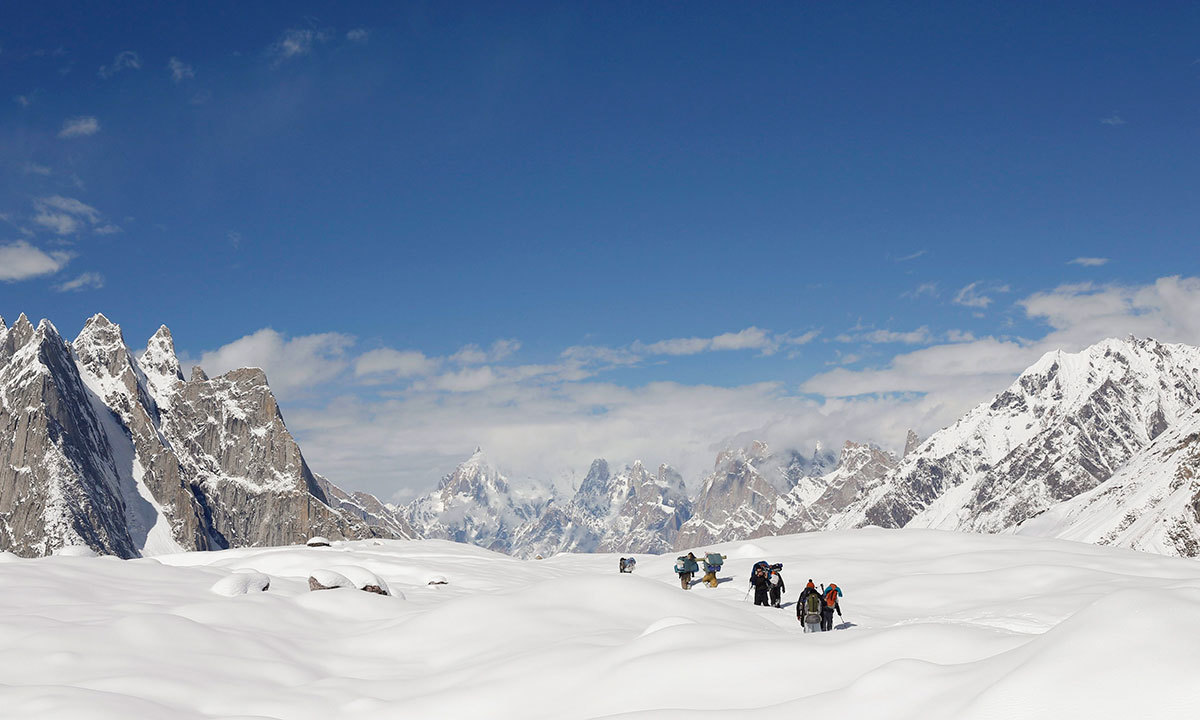 Trekkers and porters hike down the Baltoro glacier in the Karakoram mountain range in Pakistan. -Reuters Photo