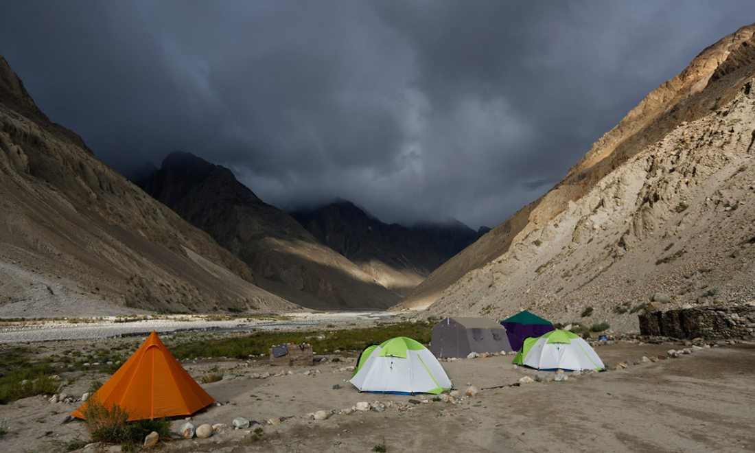 Tents stand under dark rain clouds in the valley of the river Braldu at Bardoumal near the Baltoro glacier in the Karakoram mountain range. -Reuters Photo