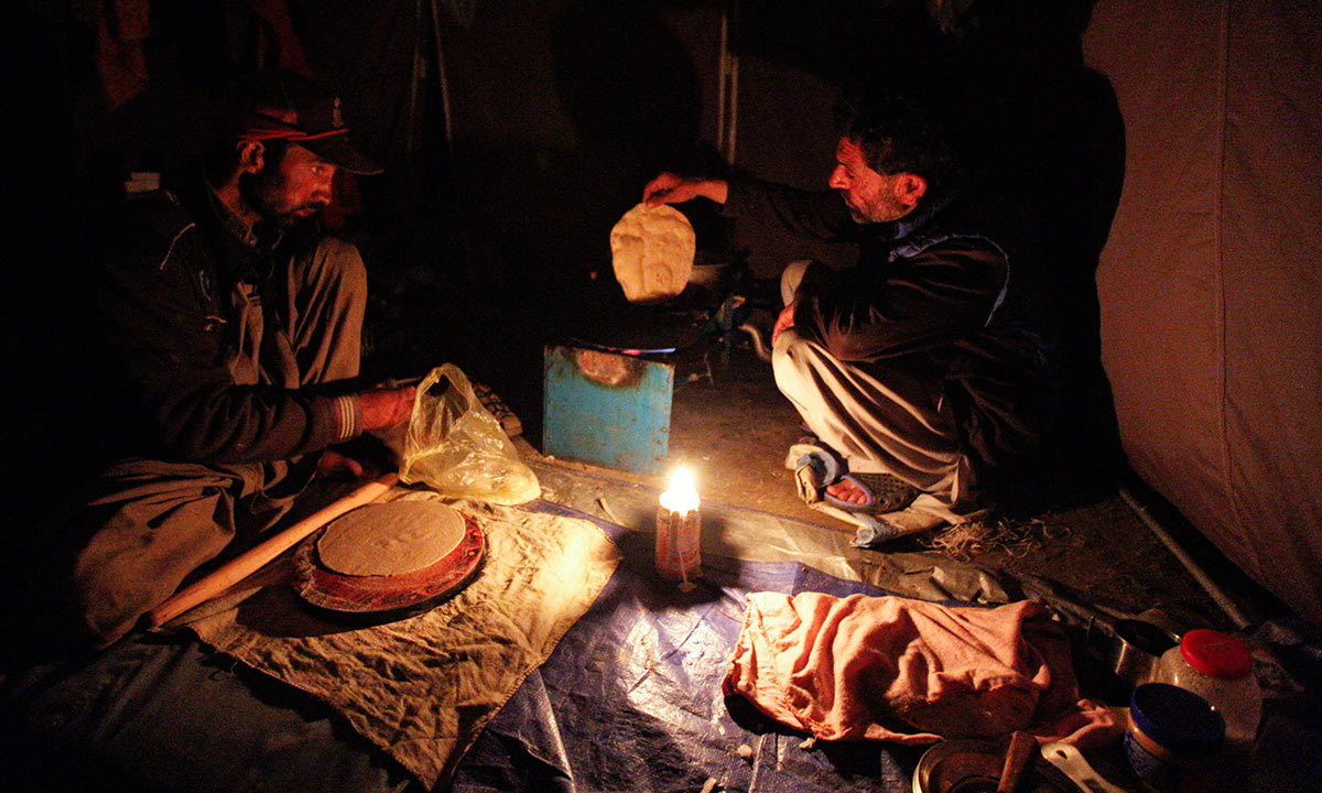 Shukrullah Baig, a 52-year-old brick layer and former cook at a five-star hotel chain cooks a chapati in the village of Askole in the Karakoram mountain range in Pakistan. -Reuters Photo