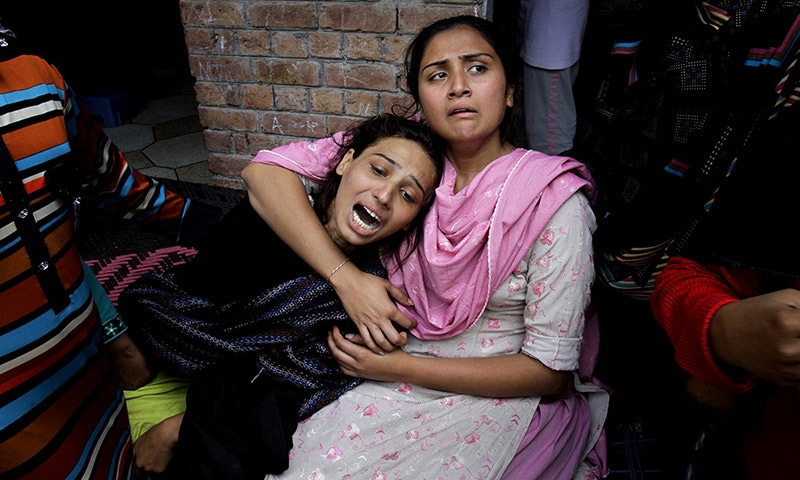 Girls mourn over a family member who was killed by a suicide bombing attack near two churches in Lahore, Pakistan, Sunday, March 15, 2015. — AP