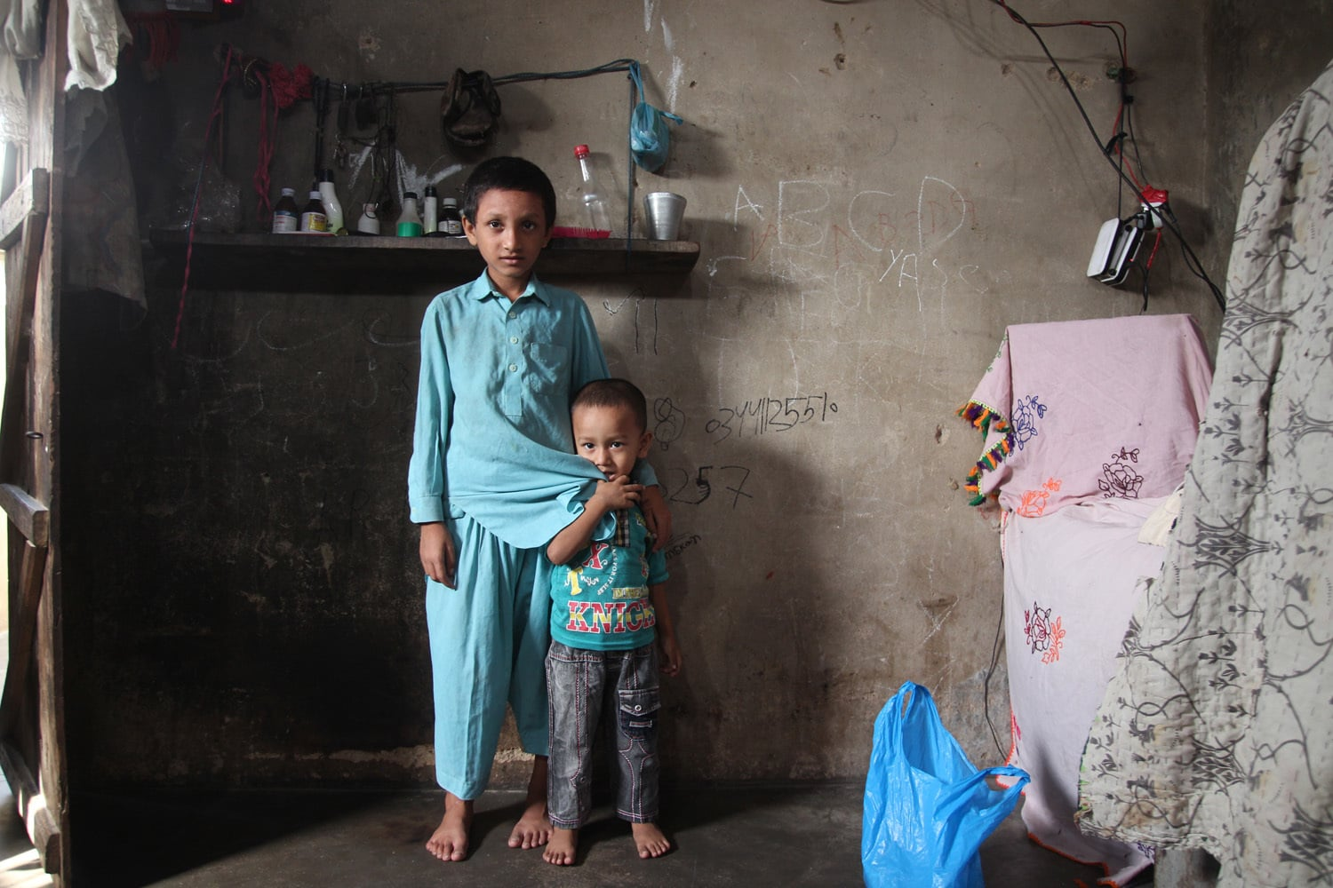 Yaseen, who studies at TCF, poses with his younger brother.