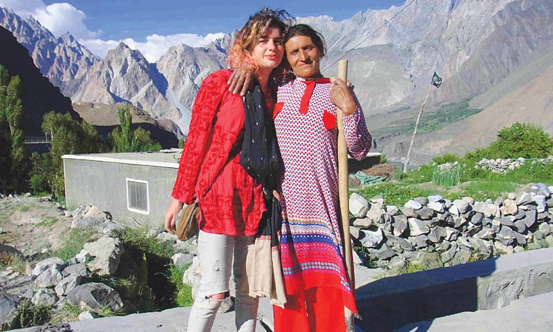 A Hussaini woman poses with a tourist from Karachi