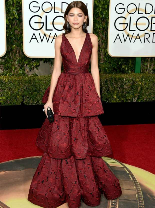 With a sleek center parting and dainty baubles, Zendaya steers clear from being OTT and looks polished. —Getty Images