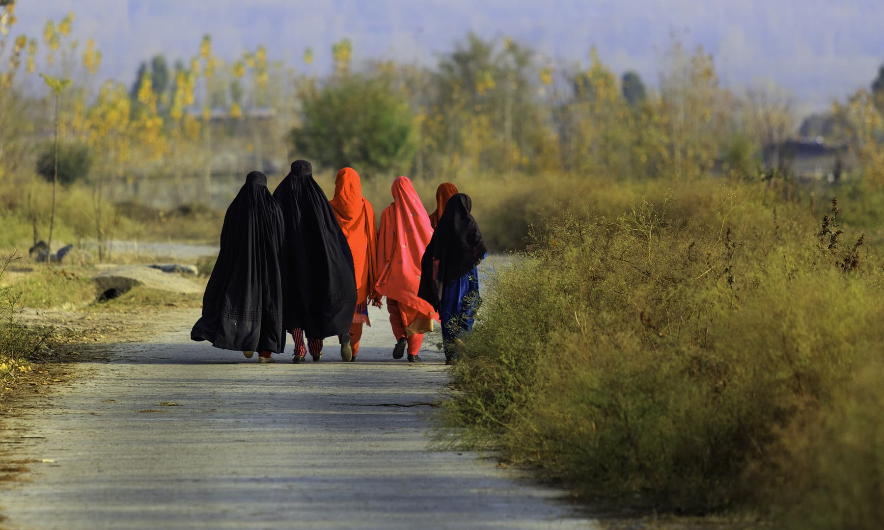 Women walking home.