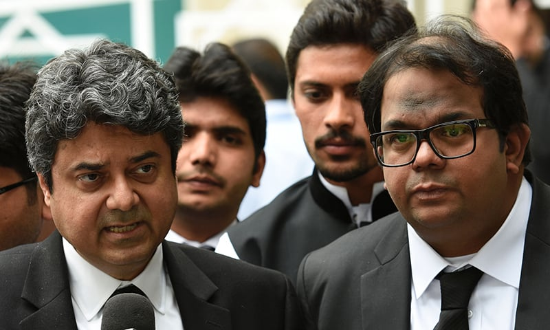 Farogh Naseem (L) and Faisal Hussain (R) lawyers of Pervez Musharraf address media representatives as they leave The Supreme Court building in Islamabad. -AFP