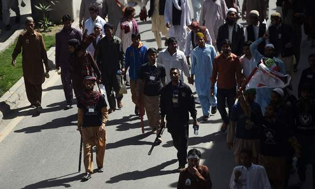 Supporters of Mumtaz Qadri shout slogans as they march during an anti-government protest in Rawalpindi on March 27, 2016. – AFP