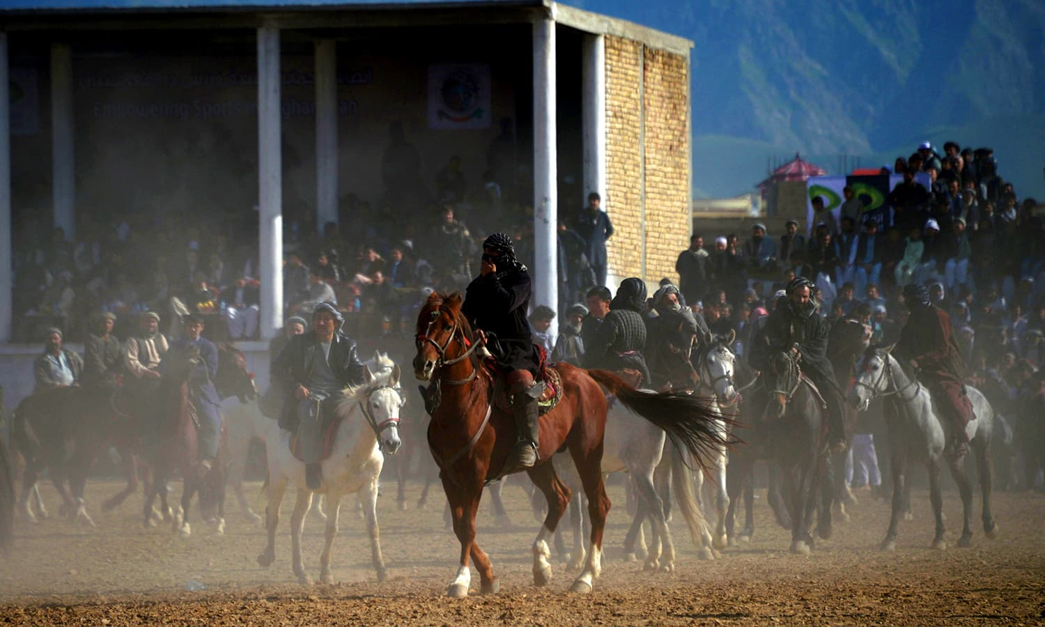 Afghan horsemen compete for a veal carcass during buzkashi during celebrations for the Persian New Year. ─ AFP