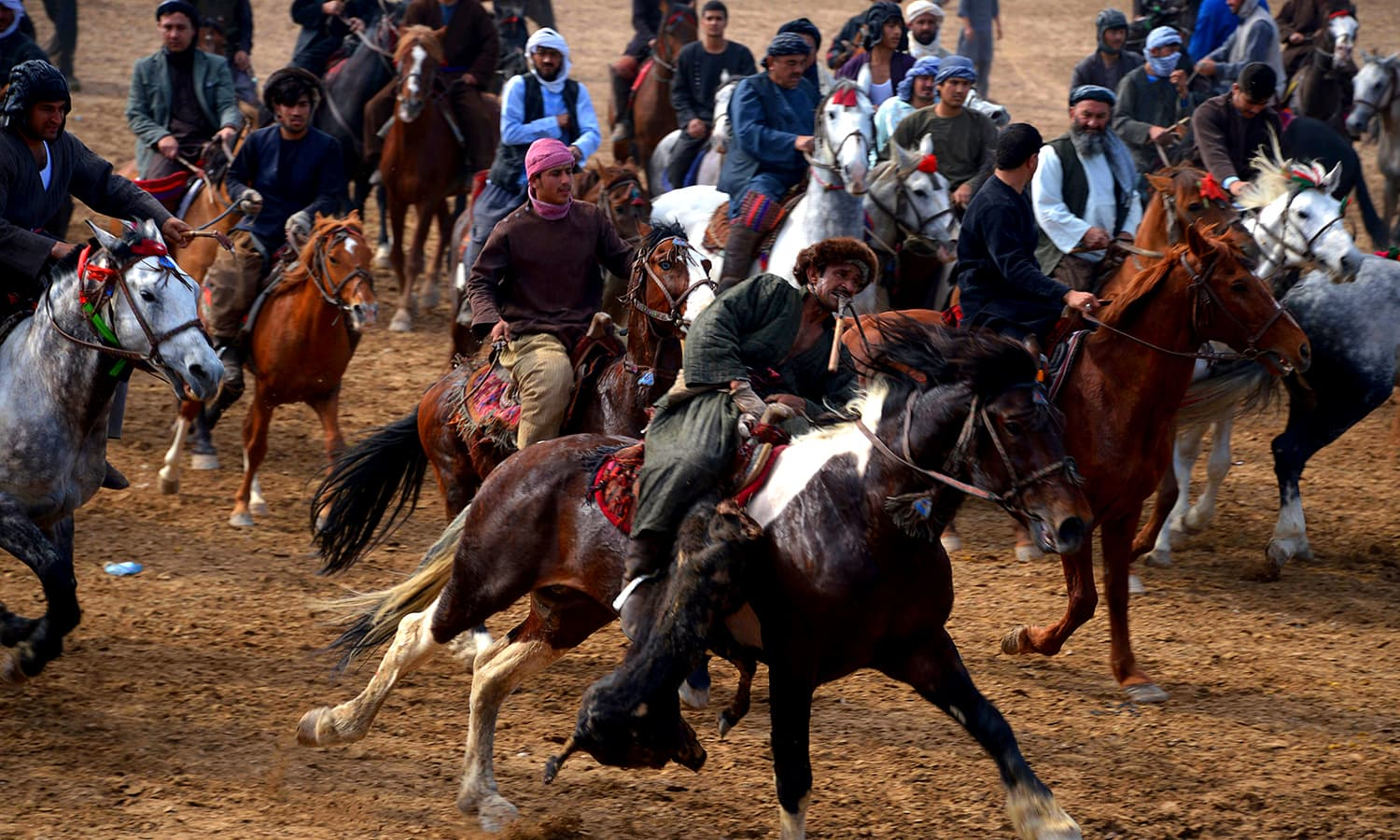 A chapandaz with a veal carcass during buzkashi. ─ AFP