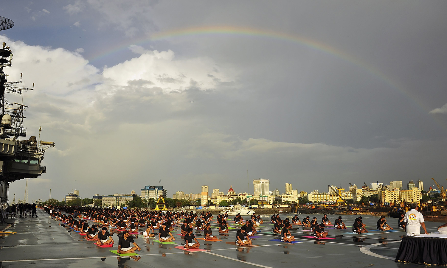 In this photograph released by the Indian Press Information Bureau (PIB), Indian Armed Forces personnel take part in a yoga sesssion to mark International Yoga Day on the Indian Navy aircraft carrier INS Viraat in Mumbai. AFP