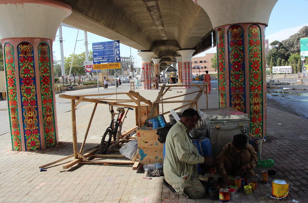Haider Ali's team paints flower motifs beneath the Jinnah Hospital Flyover in Karachi