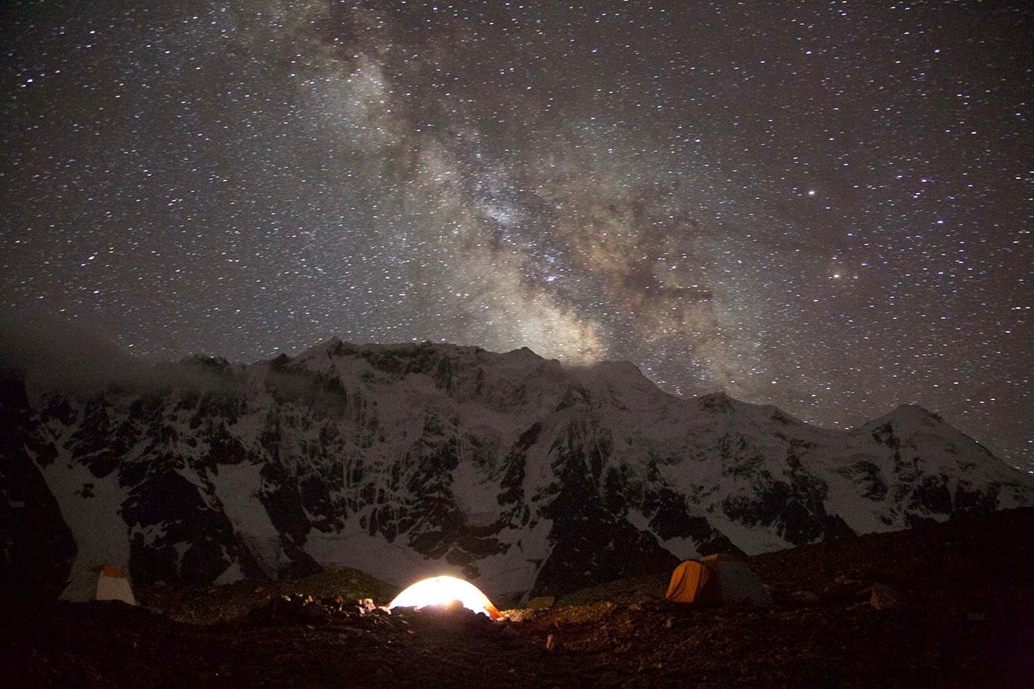 Goro II is notorious for being the coldest site. I took this photograph of the Milky Way extending from Biarchedi mountain with my tent lit up.
