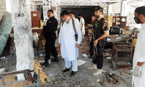 Security personnel investigate the site of the attack. ─ DawnNews