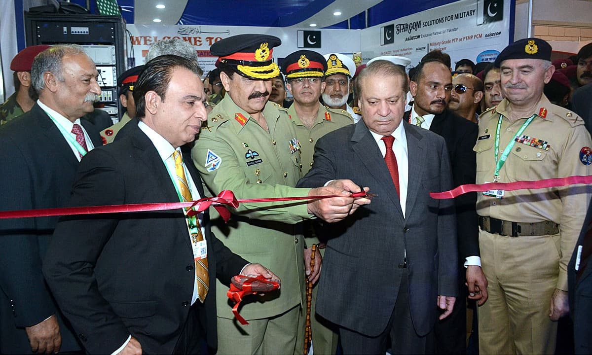 Prime Minister Nawaz Sharif with Army Chief Gen Raheel Sharif cutting the ribbon to inaugurate 9th International Defence Exhibition IDEAS-2016. —APP