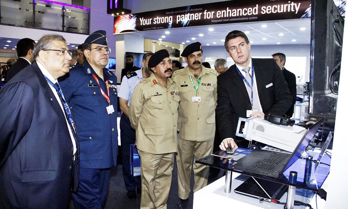 Director General of Munitions Production Major General Faiz Muhammad Khan Bangash is being briefed by Managing Director of Rohde and Schwarz in Pakistan Sameer Ahmad Siddiqui on modern equipment used to counter cyber crime attacks. —Online