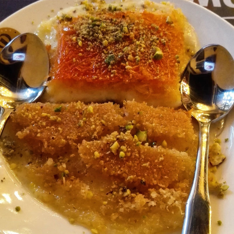 I quickly ordered Kinafeh - a Middle Eastern cheese pastry soaked in sweet, sugar-based syrup. Photo by author.