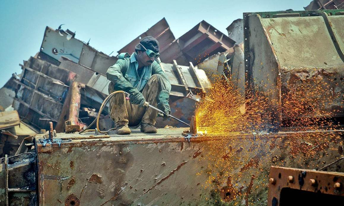 A worker operating a blowtorch. Credit: Herald/White Star