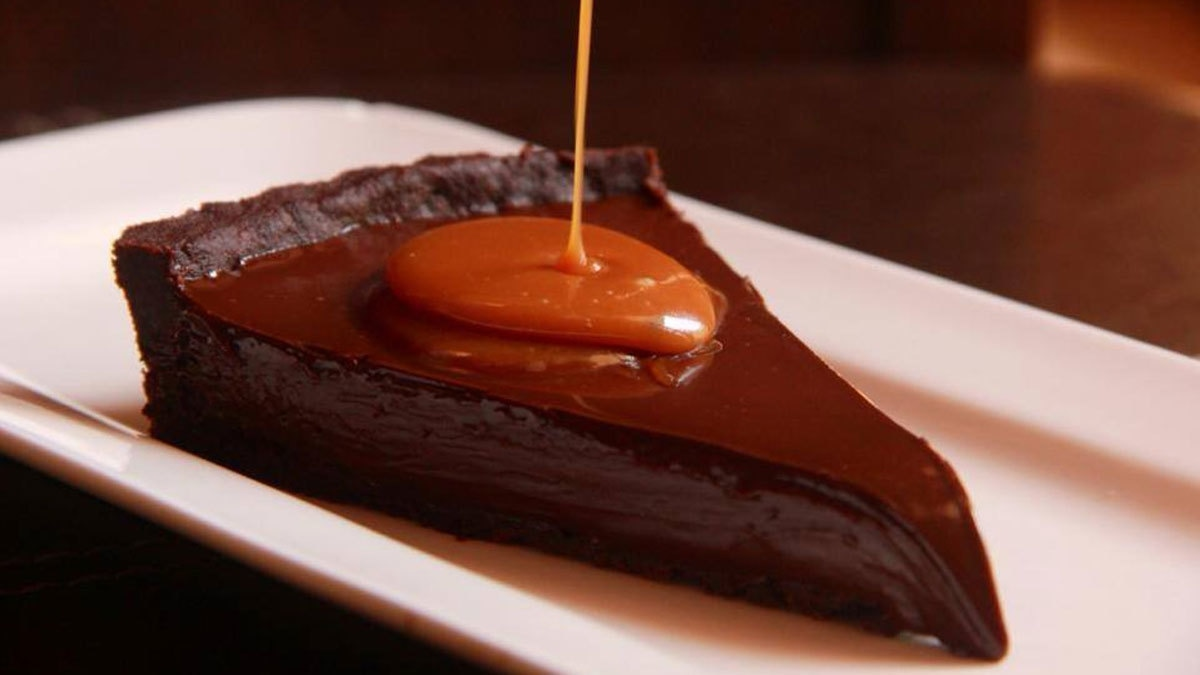 Xander's famous chocolate tart adds the perfect bit of saltiness with the Smoked Salted Caramel. Photo: Xander's/Facebook