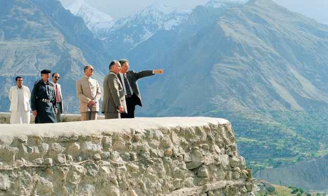 His Highness the Aga Khan admiring the breath-taking view from Baltit Fort. The conservation of the over 700-years-old Baltit Fort, the pre-eminent landmark monument in Gilgit-Baltistan, and the rehabilitation of the historic core of the Karimabad village in Hunza Valley, were the Aga Khan Historic Cities Programme first major interventions, completed in 1996.