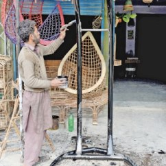 Hanging Chair Lahore Bicycle Seat Office A New Spin On An Old Trend Newspaper Dawn Com Painter Paints Wrought Iron Stand For Swing