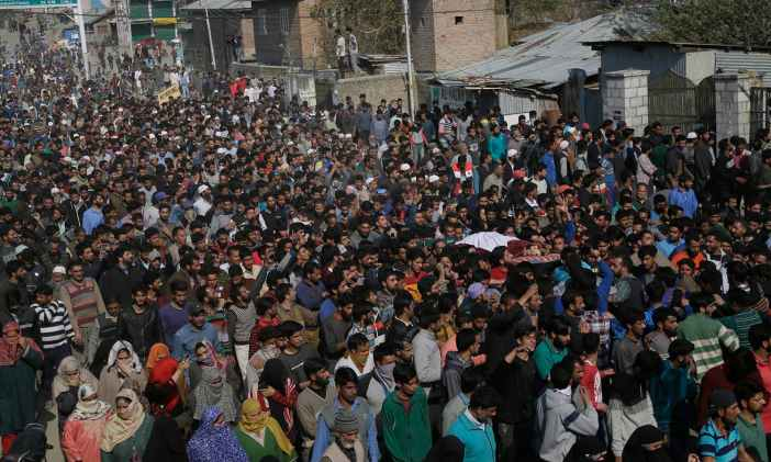 Villagers carry the body of Zubair Ahmad during his funeral at Shopian, south of Srinagar. —AP